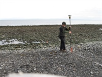 Miller uses a GPS receiver to survey the coastline in Washington state.