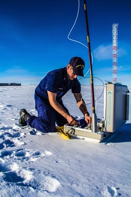 NOAA Corps Officer Joe Phillips samples air at the South Pole.