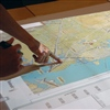 WeTable users examine a map at a planning issues workshop in Galveston, Texas.