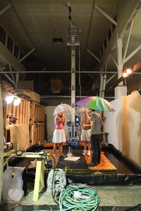 "A NOAA scientist and Exploratorium staff perform indoor tests on the new ""Remote Rains"" exhibit."