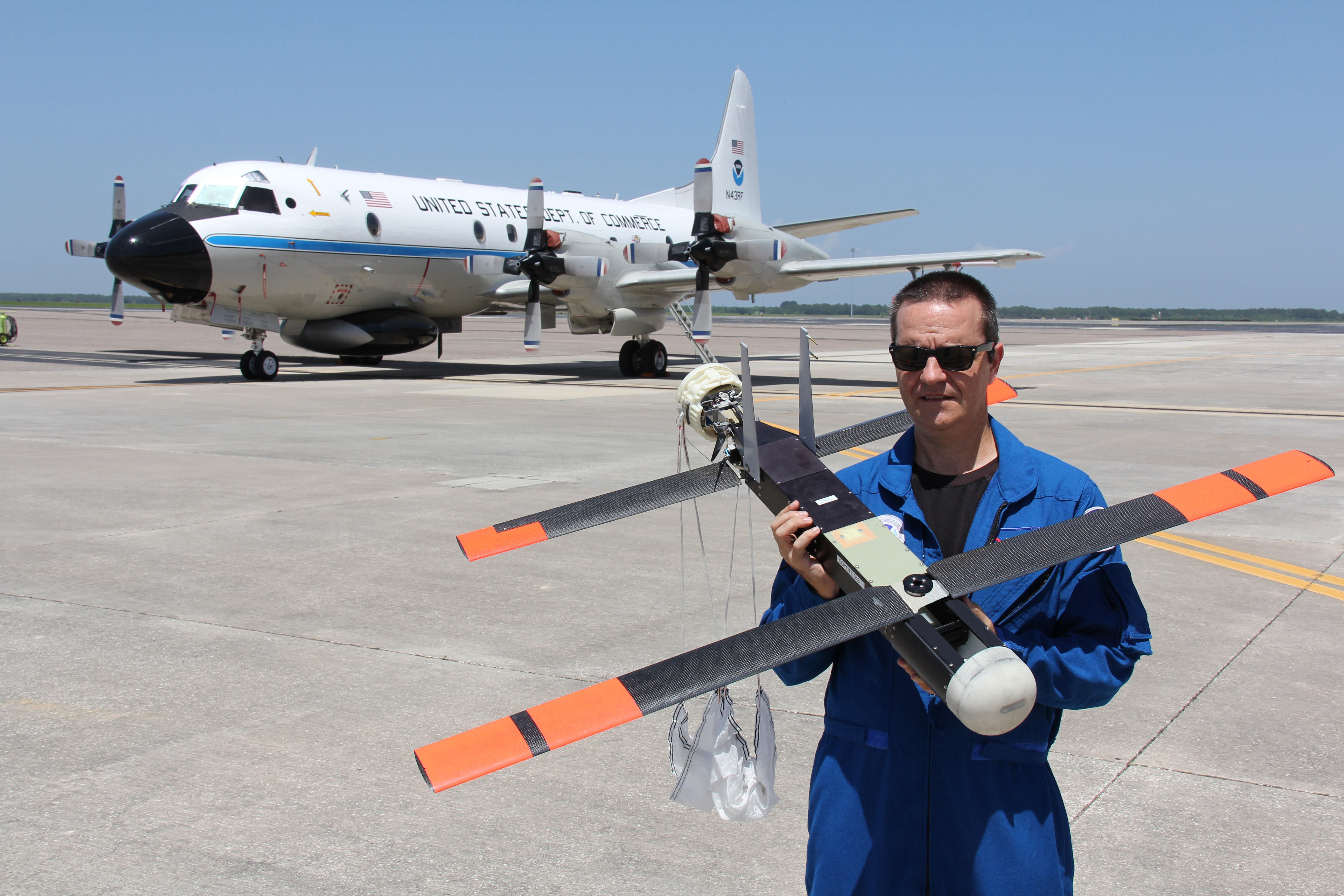 A researcher holding a Raytheon Coyote canister-launched drone Credit: NOAA